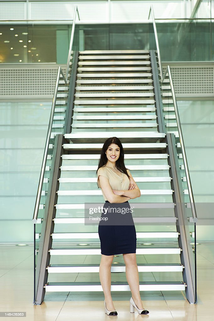 Businesswoman standing in modern office : Stock Photo