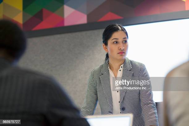 Businesswoman standing in office meeting