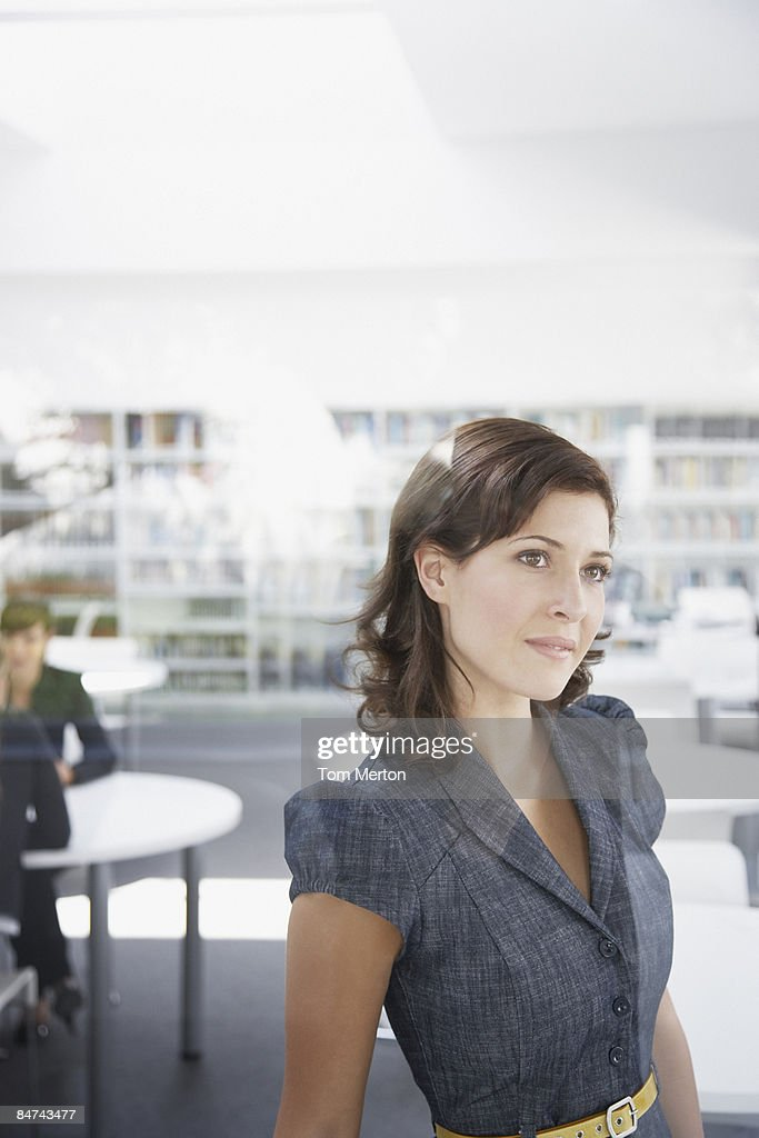 Businesswoman standing in office : Stock Photo