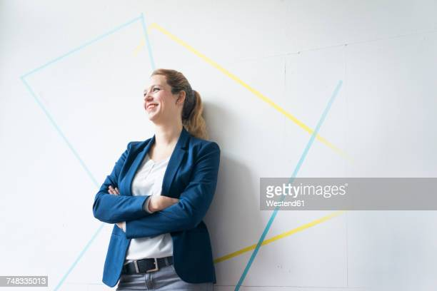 businesswoman standing in office with arms crossed - 女性建築家 ストックフォトと画像
