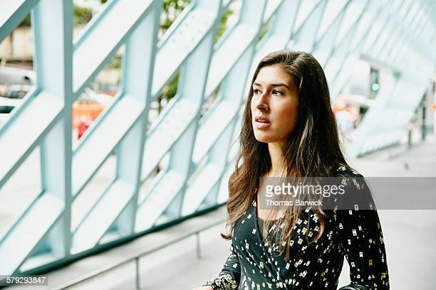 Businesswoman standing in outdoor corridor