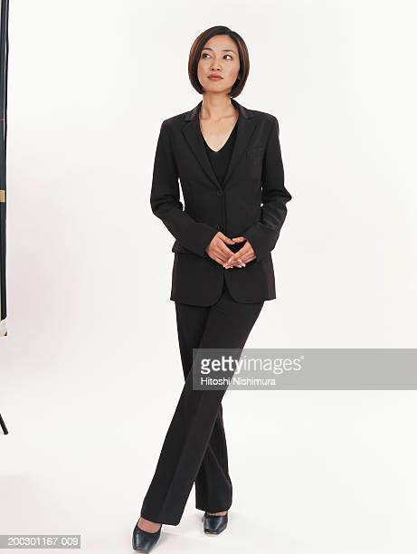 Businesswoman standing, looking to side