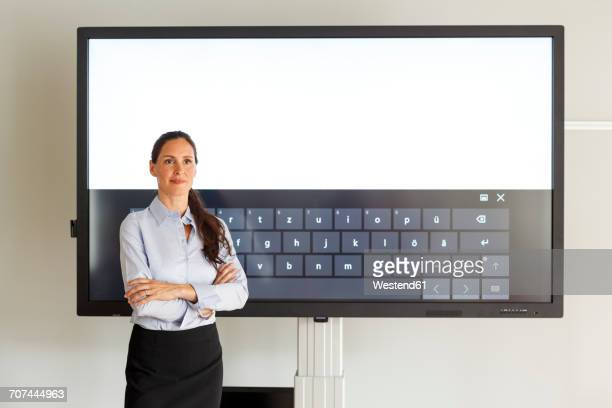 Businesswoman standing of projection of a keyboard
