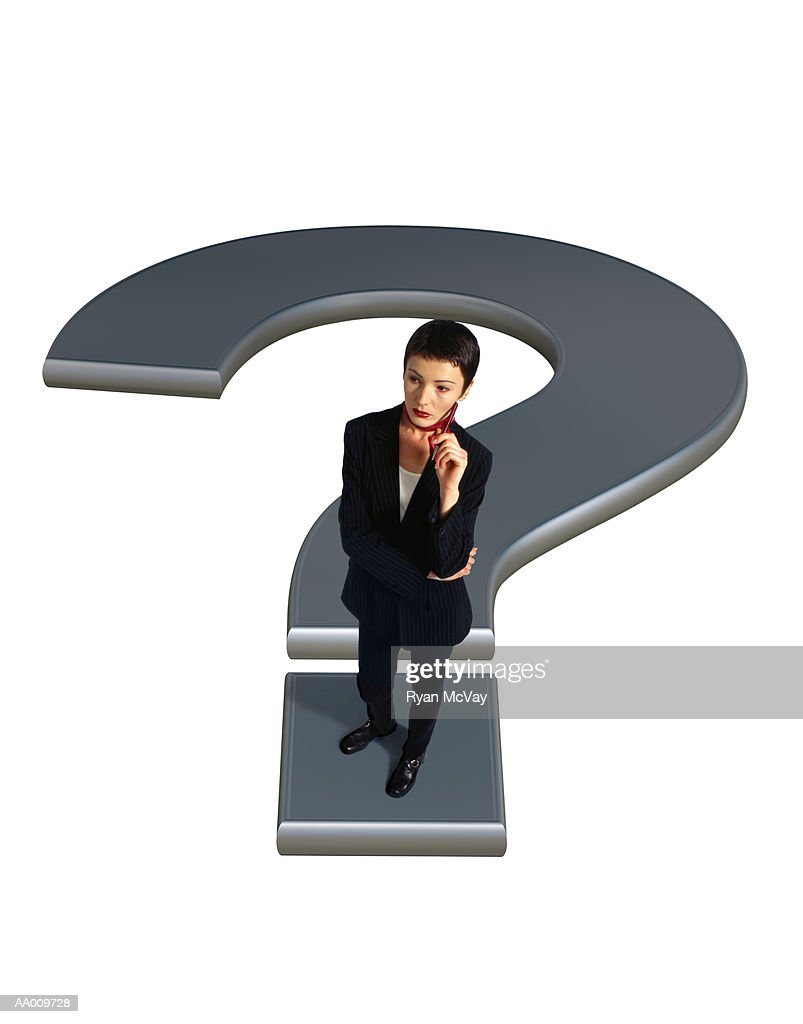 Businesswoman Standing on a Question Mark : Stock Photo