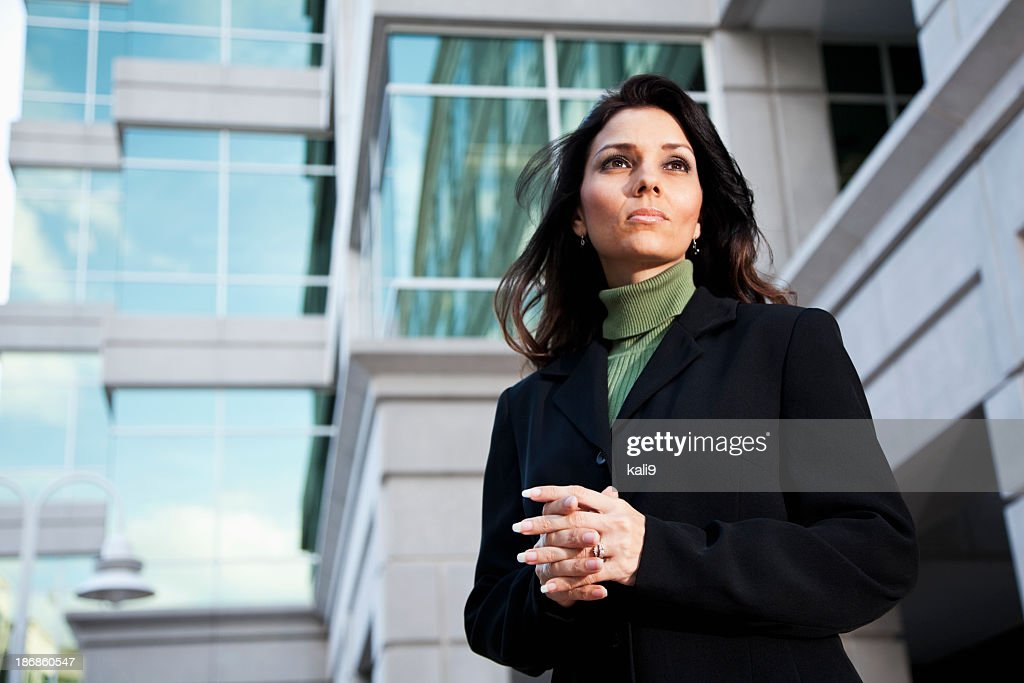 Businesswoman standing outside office building : Stock Photo