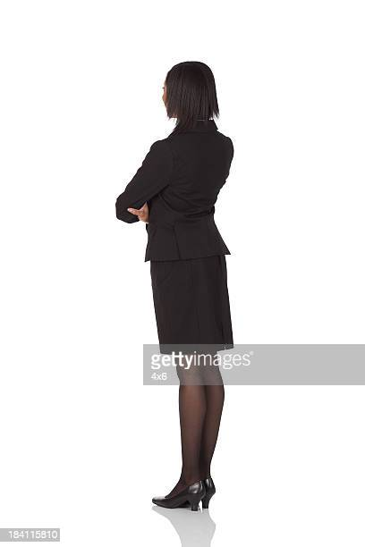businesswoman standing with arms crossed - black bum stock pictures, royalty-free photos & images