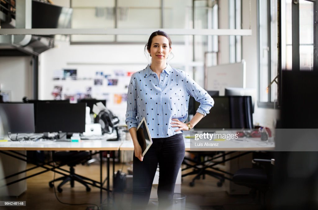 Businesswoman standing with digital tablet : Stock Photo