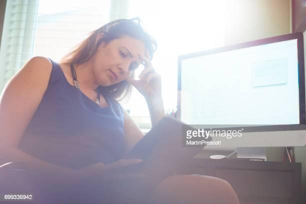 Businesswoman struggling with finances