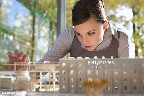 Businesswoman Studying an Architectural Model