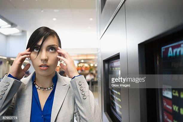 Businesswoman suffering from a headache at an airport