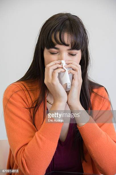 Businesswoman suffering from cold and flu