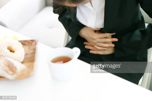 businesswoman suffering from stomachache - pms stock pictures, royalty-free photos & images