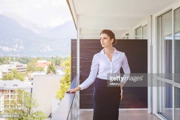Businesswoman taking a break at hotel room balcony
