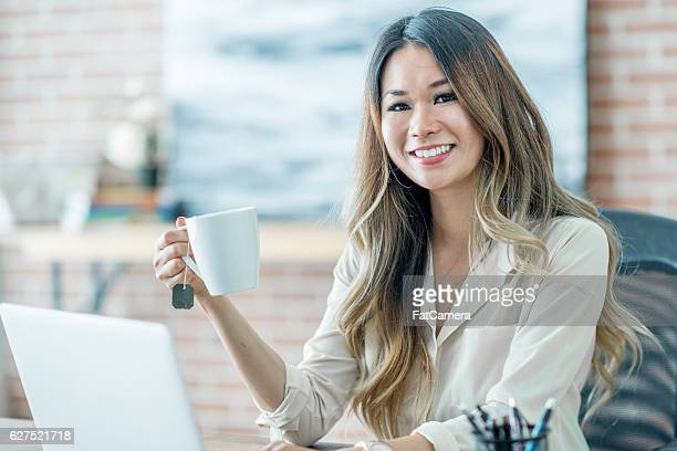 Businesswoman Taking a Break at Work