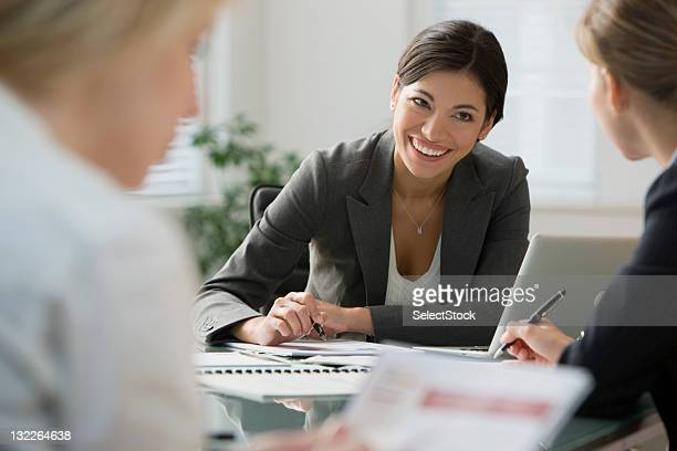 Businesswoman taking notes in a meeting