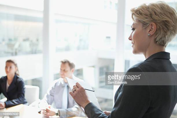 Businesswoman taking notes in meeting