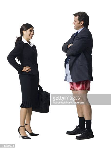 Businesswoman talking and smiling with businessman in boxers