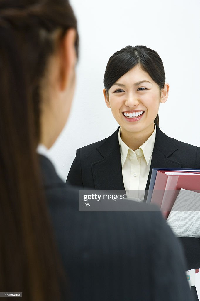 Businesswoman Talking, Front View, Rear View, Head and Shoulder, Differential Focus : Photo