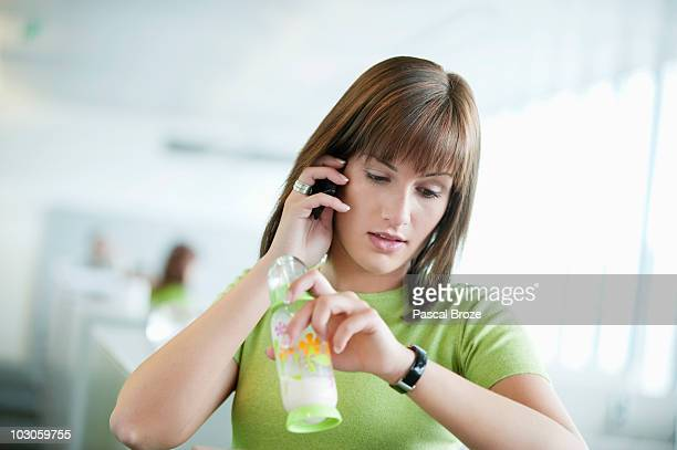 Businesswoman talking on a mobile phone and checking the time