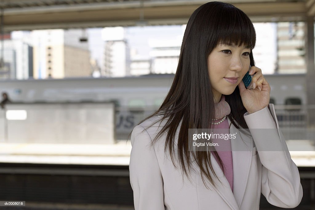 Businesswoman Talking on a Mobile Phone : Stock Photo
