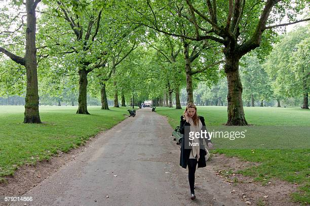 Businesswoman talking on cell phone in a Park