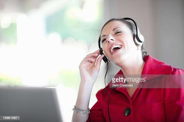 businesswoman talking on headset - funny customer service stock pictures, royalty-free photos & images