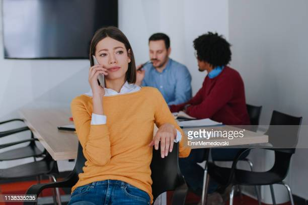 businesswoman talking on mobile phone in the office - managing director stock pictures, royalty-free photos & images