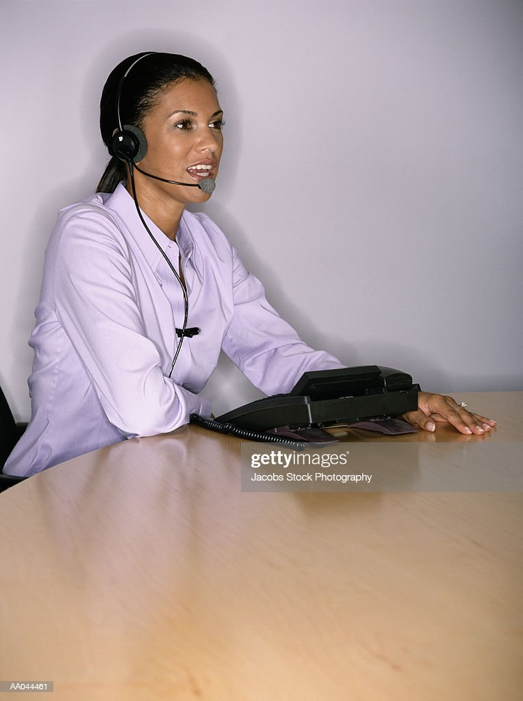 Businesswoman Talking On Phone Using Headset High Res Stock Photo Getty Images