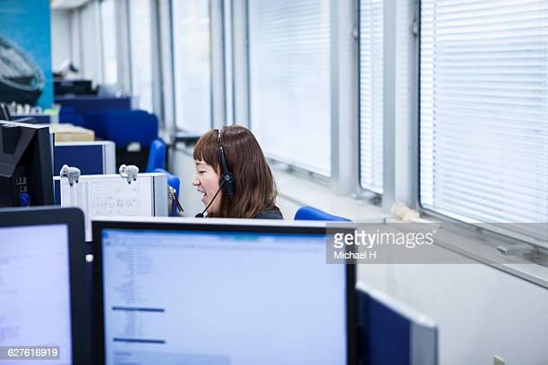 Businesswoman talking on telephone in office