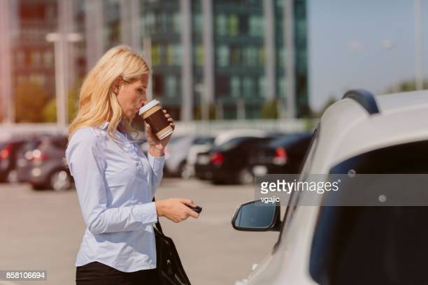 businesswoman talking on the phone - car alarm stock photos and pictures