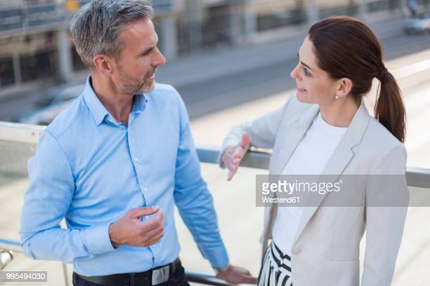Businesswoman talking to business partner