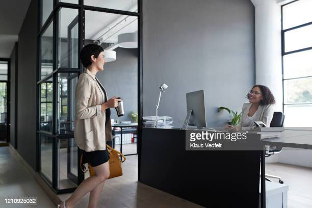 businesswoman talking to coworker in office - pregnant coffee stock pictures, royalty-free photos & images