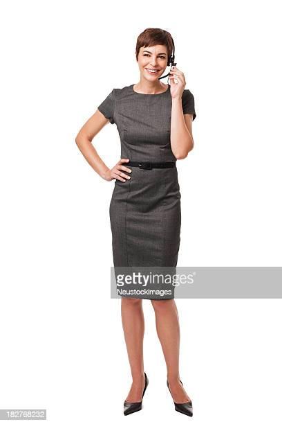 businesswoman talking with headseat. isolated on white - telefoonberoep stockfoto's en -beelden