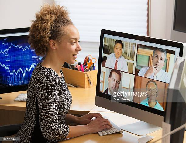 businesswoman teleconferencing from home - video conference stock pictures, royalty-free photos & images