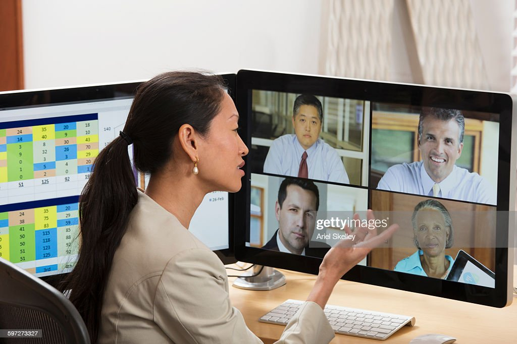 Businesswoman teleconferencing from home : Stock Photo