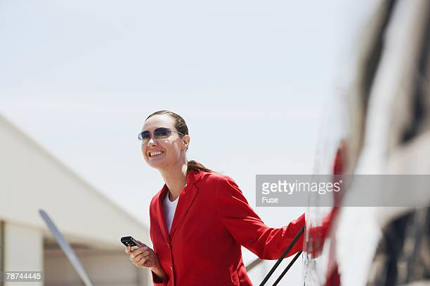 Businesswoman Telephoning Outside Private Jet