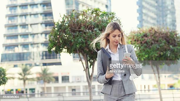 Businesswoman texting in Dubai