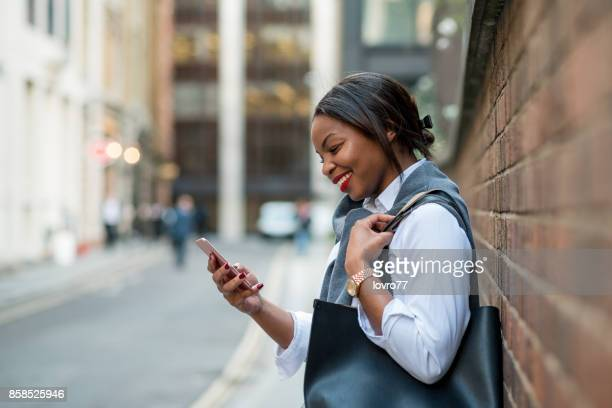 Businesswoman texting on her phone