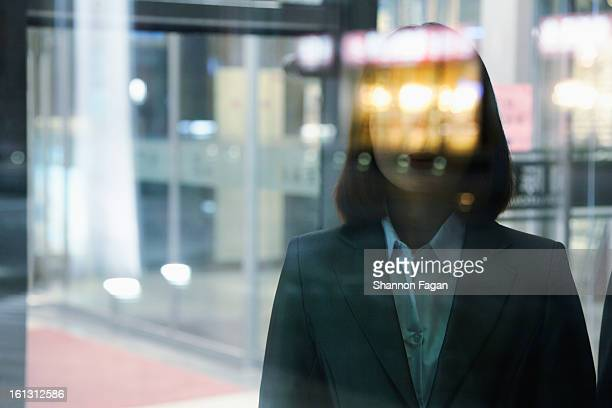 Businesswoman through a window at night