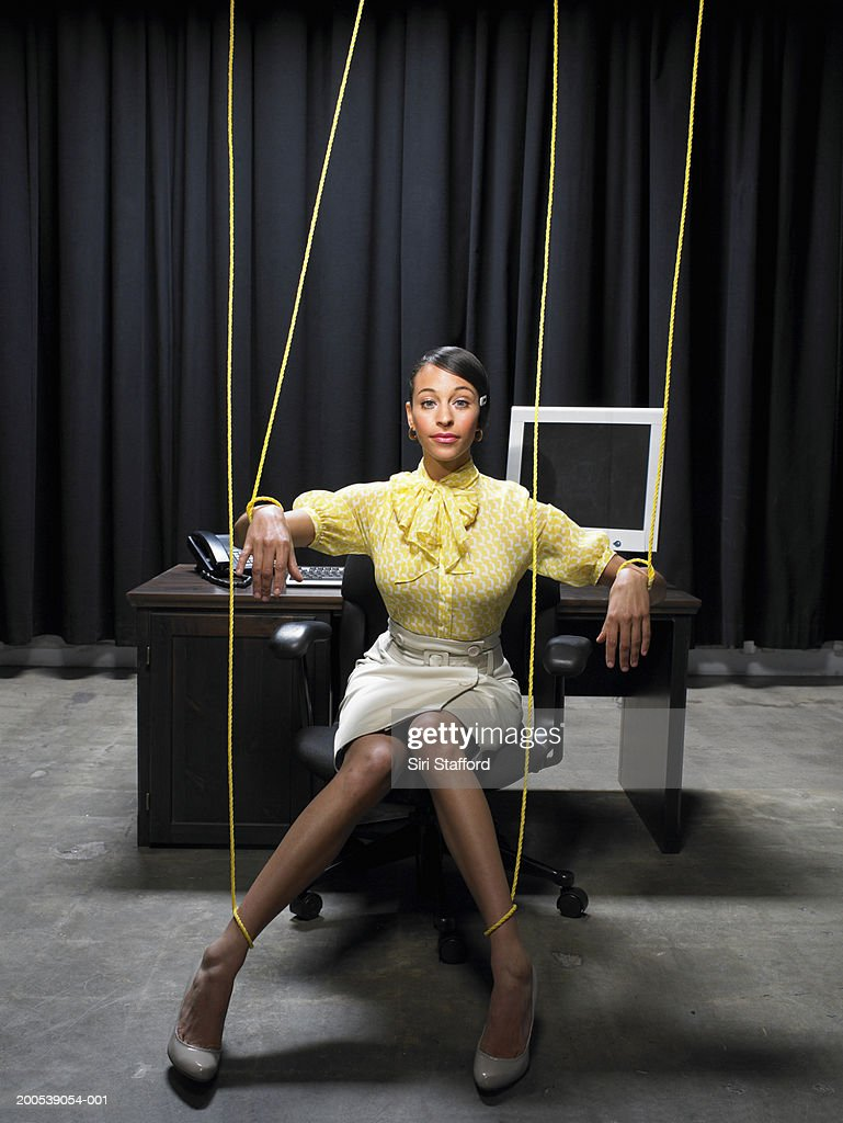 Businesswoman Tied Up In Strings High-Res Stock Photo -4056