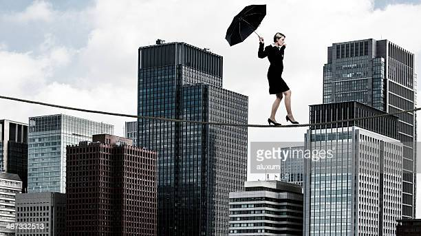 Businesswoman tightrope walker