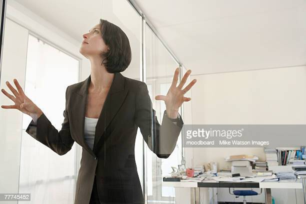 Businesswoman Trapped in Glass Office