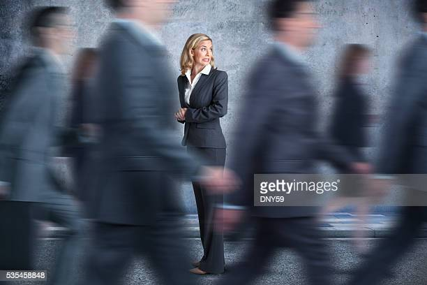 Businesswoman Turns Head To Look In Direction Pedestrians Are Walking