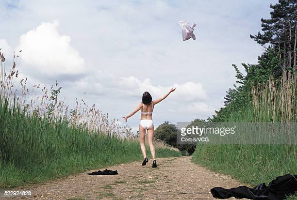 Businesswoman Undressing on Trail