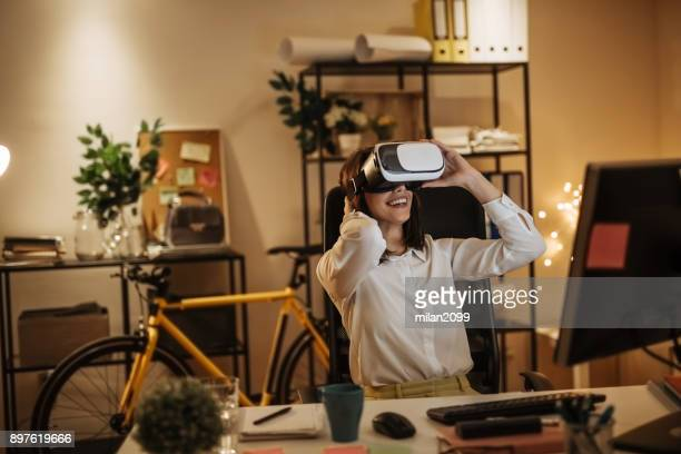 Businesswoman using 3-D Glasses in her office