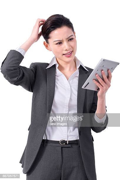 Businesswoman Using a Calculator