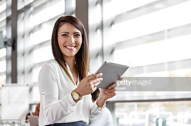 businesswoman using a digital tablet in an office - touchpad stock pictures, royalty-free photos & images