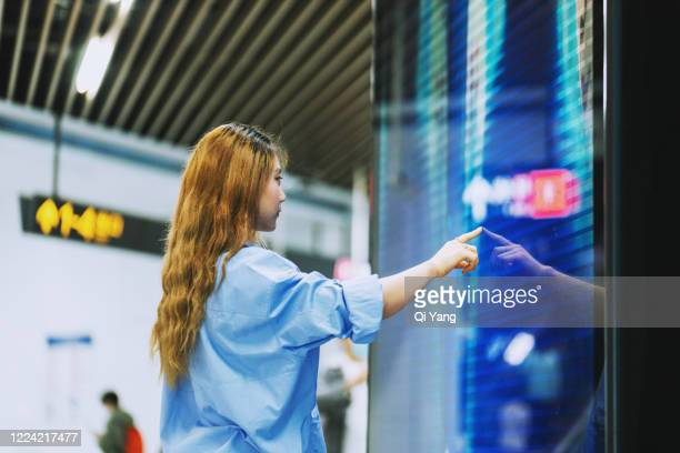 businesswoman using a large touch screen in the subway station - shanghai stock pictures, royalty-free photos & images