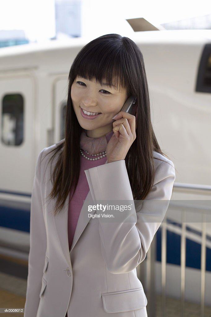 Businesswoman Using a Mobile Phone : Stock Photo