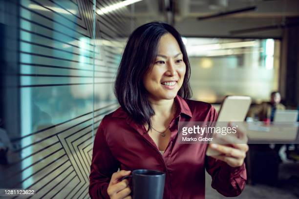 businesswoman using a phone - females stock pictures, royalty-free photos & images